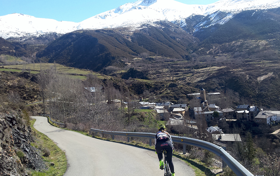 A cyclist going down one of the passes in the Benasque Valley, a pure rush of adrenaline between winding roads and towns.
