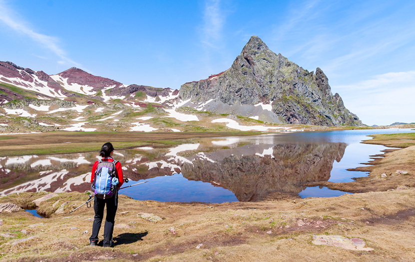 Views of Pic d'Anayet and the reflection of its summit in the water of one of the Ibones.