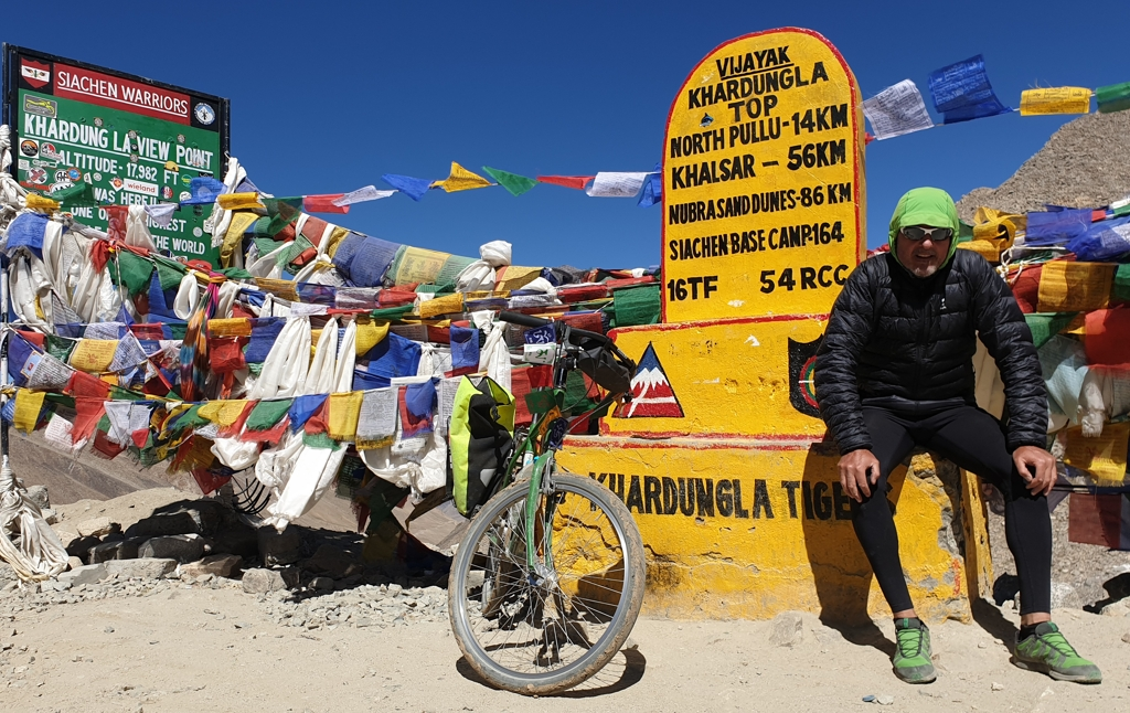 "Mikel Bringas and his bicycle in the mountain pass of ""Khardung La"" in India"