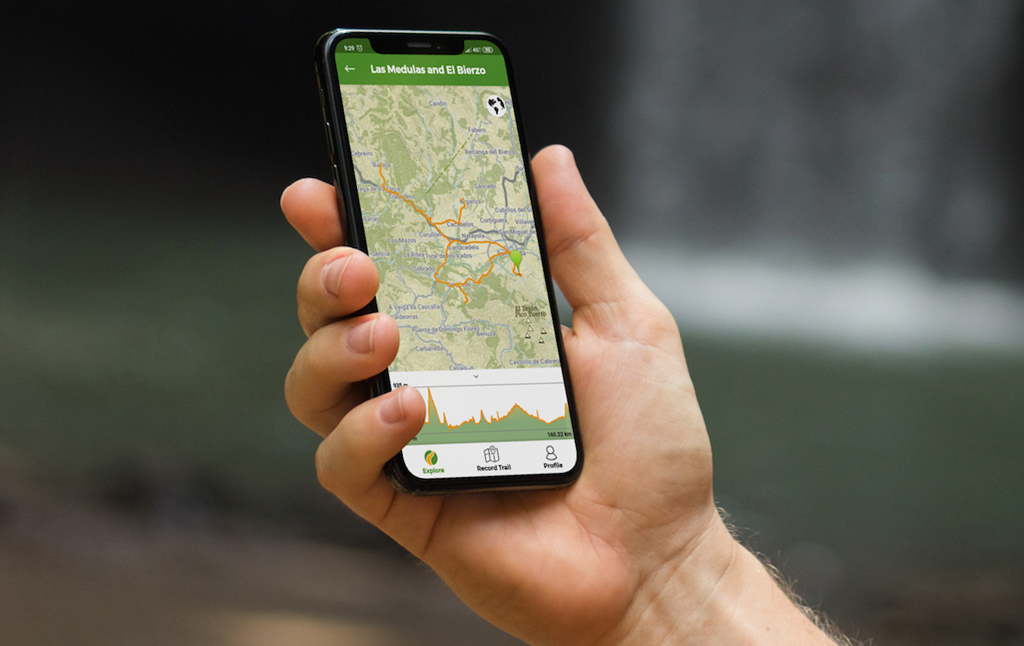 A mobile phone with an offline Wikiloc map on the screen