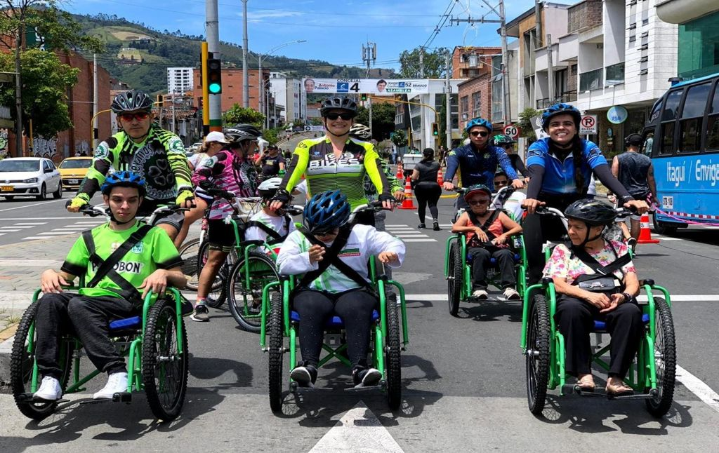 On route in a group of inclusive cycling with adapted bicycles