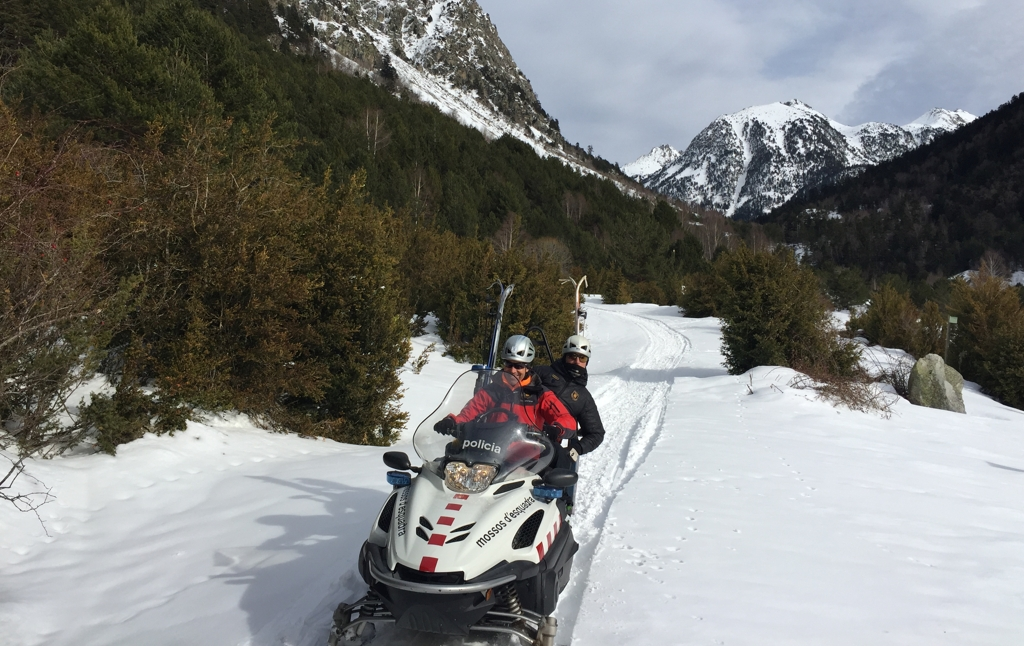 Mossos d'Esquadra offices from the MIU on a snowmobile in the line of duty