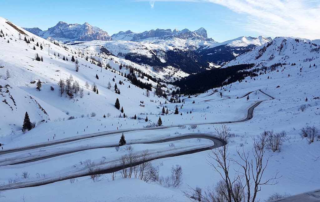 Snowy landscape along the road in the Sella Ronda, among the Dolomites.
