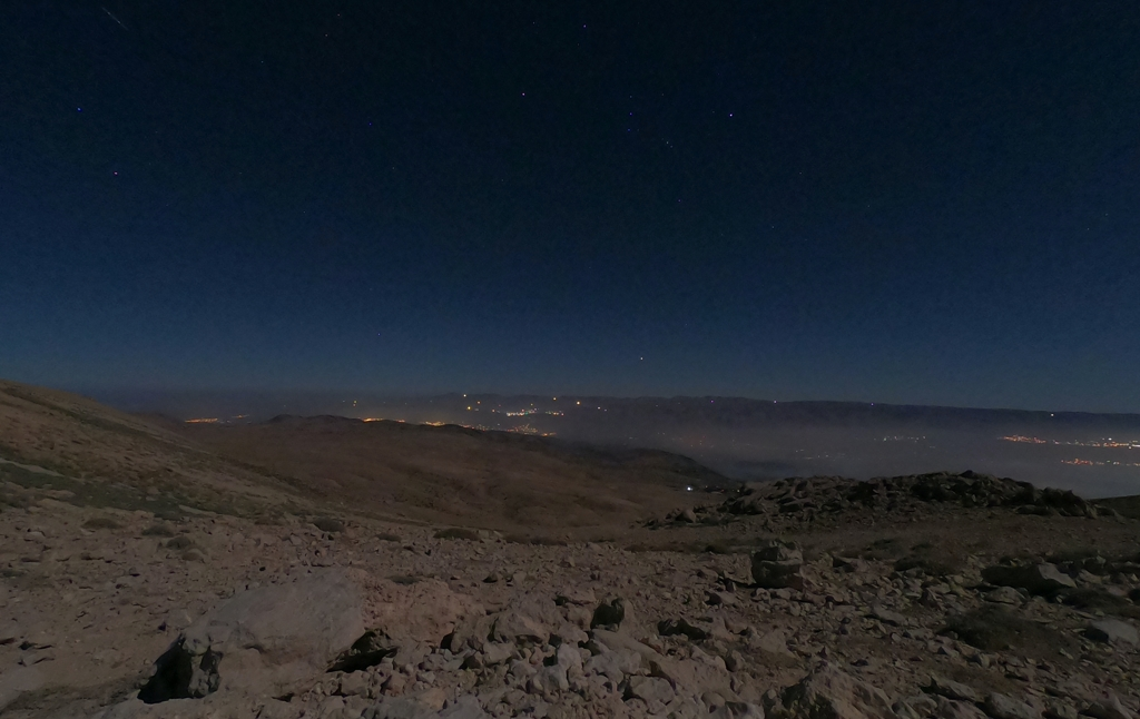 Views of the Beqaa Valley and Zahlé seen from the Qurnat as Sawdā' Mountain on a starry night.